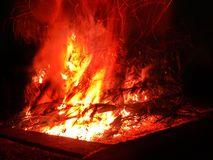 A burning red-orange huge bonfire royalty free stock image