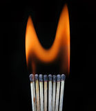 Burning row of matches Royalty Free Stock Images