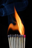 Burning row of matches Stock Photo