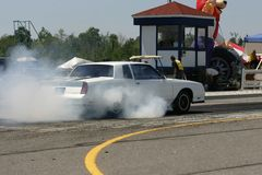 Burning rubber 3. Hot rod revving up Stock Photo
