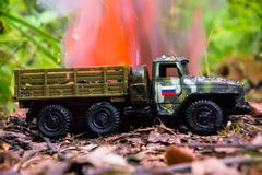 Burning of a russian military toy truck. Imitation of unexpected attack. stock image