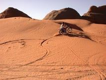 Burning Sand. Zipping through the wind strewn dunes stock image