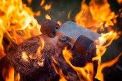 Burning skateboard royalty free stock photo
