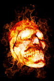 Burning Skull. As a symbol of the dead or dangers.  on a black background Stock Images