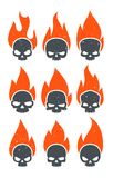 Burning Skulls Icons. Abstract aggressive angry burning skulls badges collection. Flaming evil dead head stickers for notebooks or extreme sports inventory Royalty Free Stock Photos