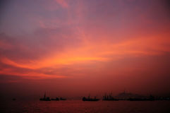 Burning Sky. Over the sea with some boat on the surface stock image