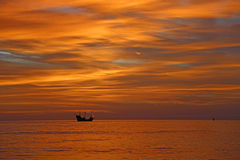 Burning sky over gulf Stock Image