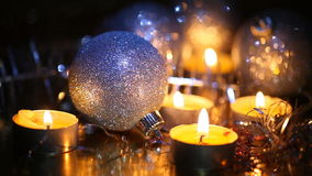 Burning small candles and Christmas tree decorations stock footage