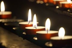 Burning small candles - religion concept. Burning small candles - great for topics like religion, spirituality etc stock photos