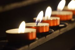 Burning small candles - religion concept. Burning small candles - great for topics like religion, spirituality etc stock images