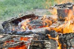 Burning smoldering firewood with black background Stock Photo