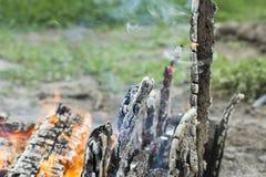 Burning smoldering firewood with black background Royalty Free Stock Images
