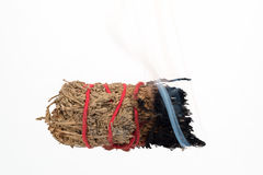 Burning Smudge Stick. Burning Smudge Stick used for purification Stock Image