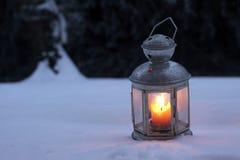 Burning in the snow lantern Stock Image