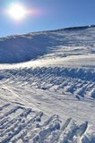 burning snowsunspår under Fotografering för Bildbyråer