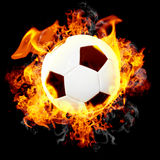 Burning soccer ball. Abstract burning leather soccer ball Stock Photography
