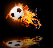 Burning soccer ball. Abstract burning leather soccer ball with reflection Royalty Free Stock Photos