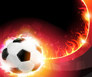 Burning soccer ball. Flaming soccer ball on a burning background. Abstract soccer background Royalty Free Stock Images