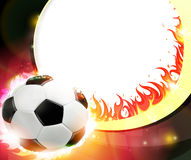 Burning soccer ball. Flaming soccer ball on a burning background. Abstract soccer background Stock Photography