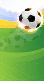 Burning soccer ball on playing field. Soccer ball illuminated by spotlights on a green background. Abstract sports background Royalty Free Stock Photos