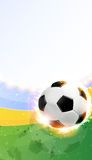 Burning soccer ball on playing field. Soccer ball illuminated by spotlights on a green background. Abstract sports background Stock Photo
