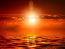 burning solnedgång Arkivfoto