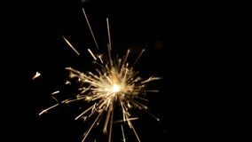 Burning sparkler or bengal light in darkness stock video footage