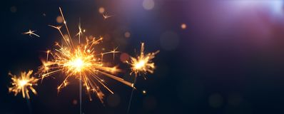 Happy New Year. Burning sparkler, Happy New Year royalty free stock photography