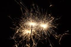 Burning sparklers on black background Stock Images