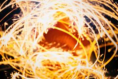 Burning Sparklers in blurred motion. Christmas New Year and Independence Day celebration lights. Royalty Free Stock Photos
