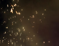 The burning sparks on a black background. The burning sparks against the background of the night sky stock photo