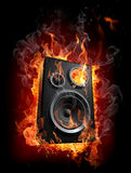 Burning speaker. On black background Royalty Free Stock Photos
