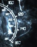 Burning speedometer. Part of burning speedometer in the smoke Stock Photography