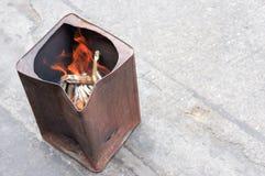 Burning spiritual bank note Royalty Free Stock Images
