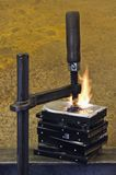 Burning stack of hard drive pressed together Royalty Free Stock Photography