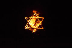 Burning star of david. Part of israeli independence day tradition, during which a fire show staring national signs and current event humour or sarcastic slogans Royalty Free Stock Photos