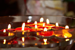 burning stearinljus röd wax Royaltyfri Bild