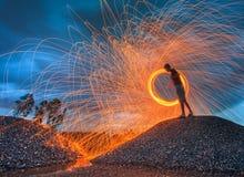 Burning steel wool. Burning a steel wool fireworks stock photography