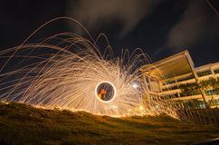 Burning steel wool sparks light trail Royalty Free Stock Photo