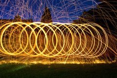 Burning steel wool spin in circles to make patterns Royalty Free Stock Photo