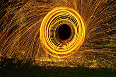 Burning steel wool spin in circles to make patterns Stock Images