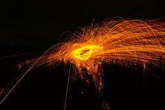 Burning steel wool spinned in the forest. Showers of glowing spa royalty free stock photos