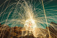 Burning steel wool on stone. Royalty Free Stock Photography