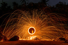 Burning steel wool on stone Stock Photography