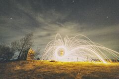 Burning steel wool under stars