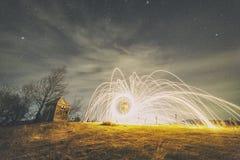 Burning steel wool under stars