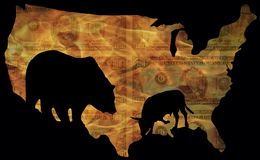 Burning stock. Large bear and small bull, the symbols of rising and falling stock courses, as silhouettes in usa map in front of burning one hundred dollar bills Stock Photo