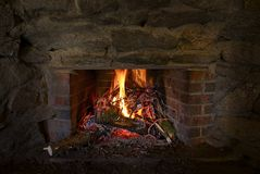 Burning Stone Fireplace Stock Photography