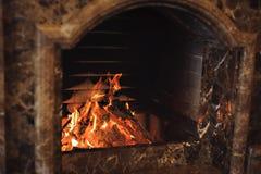 Burning Stone fireplace. Comfort. Stock Photos