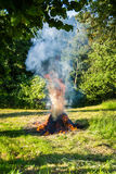 Burning straw in the countryside. Stock Photos